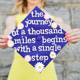 """the journey of a thousand miles begins with a single step"" with daisies"