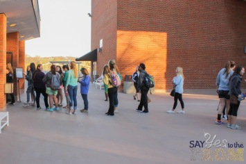 A line of JMU students extends out of Grafton-Stovall theater in preparation of the Say Yes To the Prom dress drive.