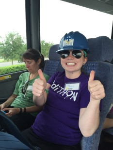 A May Break volunteer heads to the job site in the Gulf Coast, giving a thumbs up and smiling at the camera.