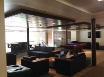 On the second floor, a large seating area overlooks the ground floor lobby.
