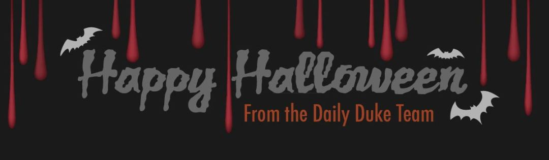 """Happy Halloween"" in gray against a black background and the words ""from the Daily Duke Team"" in orange."