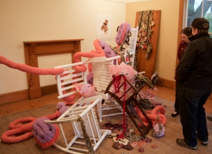 Several rocking chairs were intertwined with soft sculpture reminiscent of microbes.