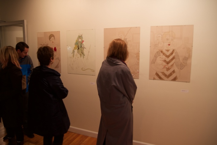 Vistors examine illustrations themed around various saints