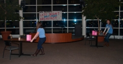 Members of UPB move tables in Festival to leave more space for the evenings activities.