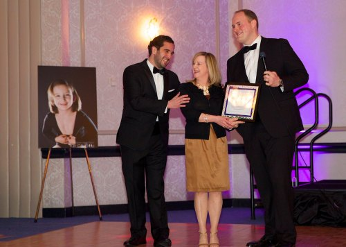 Adam Armiger (07) & presenting Sean Wainwright presening RN Martha Goldberg with the Nurse of the Year Award at the 7th Annual Hope for Hearts Casino Night
